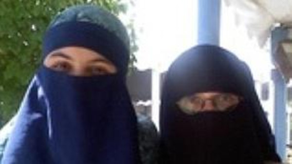 Shannon Maureen Conley, a 19-year-old who was stopped while allegedly trying to leave Denver to join ISIS in Syria, is seen pictured in a burka, left, with a friend, right.