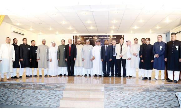 Guests and organizers at the Sir Syed Day celebrations pose for a group photo in Jeddah on Friday.