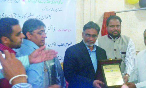 Syed Fazil Hussain Parvez is honored for his contributions to strengthen the foundations of Islam.