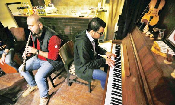 Syrian musicians perform at a restaurant in Aleppo in the government controlled side of the war-torn northern Syrian city.