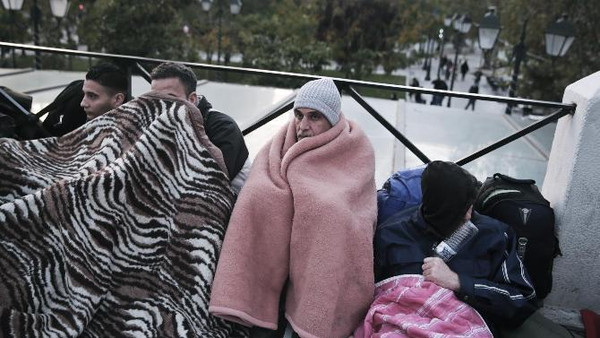 Syrian protesters are camped outside parliament in central Athens, on Monday, Nov. 24, 2014.