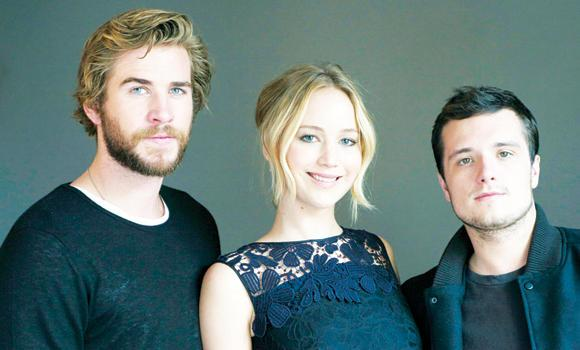 "Cast members in ""The Hunger Games: Mockingjay — Part 1"" from left, Liam Hemsworth, Jennifer Lawrence and Josh Hutcherson in New York."