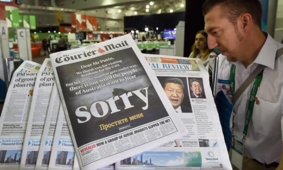 The front page of an Australian newspaper on Friday calls on Russia's President Vladimir Putin to apologize as relations between Australia and Australia hit an all-time low after the downing of Flight MH17 in Ukraine. Putin is in Brisbane, Australia to attend the G20 Leader's Summit.