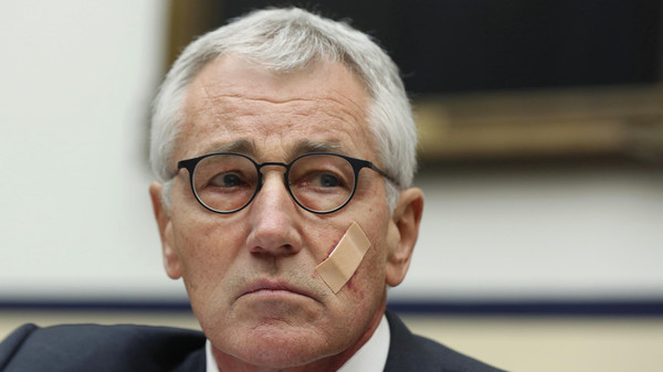 U.S. Secretary of Defense Chuck Hagel listens during his testimony at the House Armed Services Committee on Capitol Hill in Washington, Nov. 13, 2014.