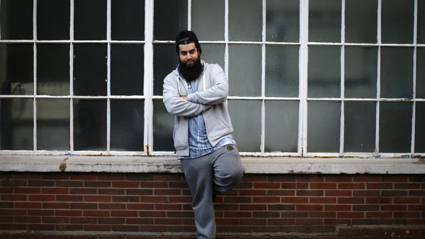 Waseem Iqbal poses for a photograph in Birmingham, central England November 20, 2014. For some British Muslims, the path to jihad and the path to peaceful aid work can much of the same terrain.