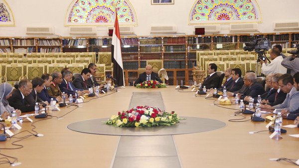 Yemen's President Abd-Rabbu Mansour Hadi (C) meets with the country's newly appointed cabinet after it was sworn-in at the Presidential Palace in Sanaa in this November 9, 2014.