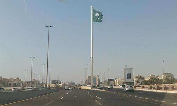 The giant Saudi flag proudly flutters atop the world's tallest flagpole in this picture taken on Oct. 15, 2014.