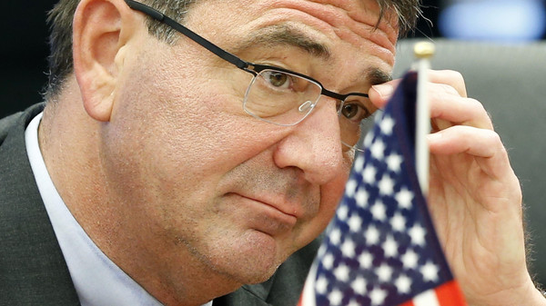 U.S. Deputy Secretary of Defense Ashton Carter adjusts his glasses during his meeting with Japanese Senior Vice Defence Minister Shu Watanabe in Tokyo in this July 20, 2012 file photo.