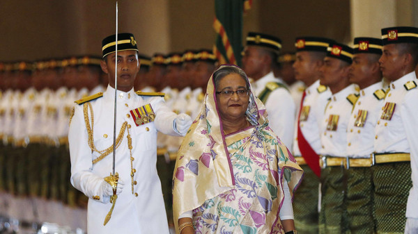 Bangladesh Prime Minister Sheikh Hasina inspects the guard of honour during a welcoming ceremony in Putrajaya
