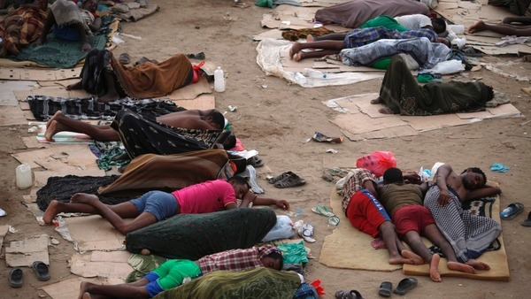 Ethiopian migrants sleep out in the open near a transit centre where they wait to be repatriated, in the western Yemeni town of Haradh, on the border with Saudi Arabia.