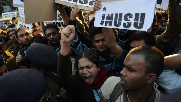 Indian residents hold placards and chant slogans as they take part in a protest against the alleged rape of a passenger by a driver working for the Uber taxi company in New Delhi on Dec. 7, 2014.