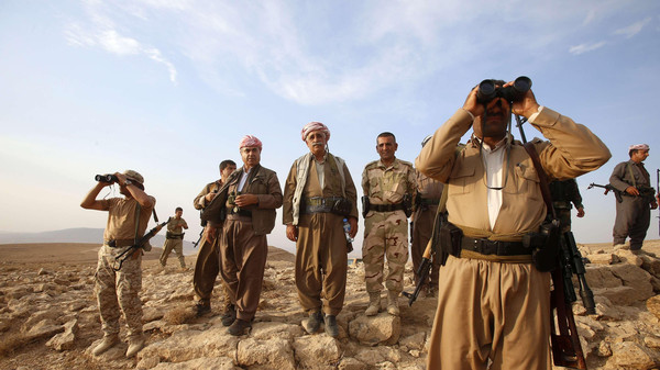 Kurdish Peshmerga forces stand guard near the town of Makhmur, south of Erbil, capital of Iraqi Kurdistan after Islamic State (IS) insurgents withdrew in this August 18, 2014.