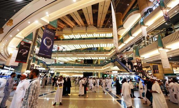 Muslim pilgrims shop at a mall near the Grand Mosque during the annual Haj pilgrimage in Makkah, in this September 27, 2014 photo.