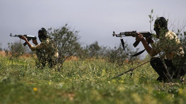 Rebel fighters take part in a training session in the northeastern city of Deir Ezzor.