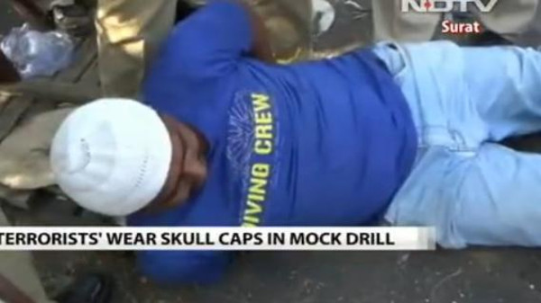 A mock 'terrorist' wears a skullcap, widely worn by Muslims in India, in this video of a 'terror' drill.