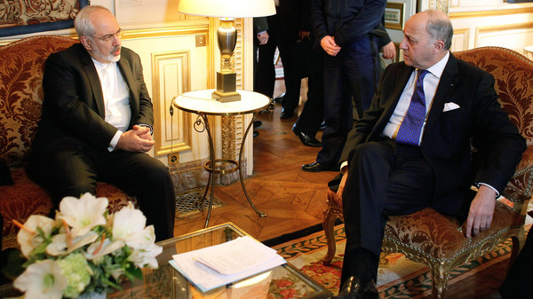 French Foreign Minister Laurent Fabius, right, talks with his Iranian counterpart Mohammad Javad Zarif during a meeting at the Quai d'Orsay, in Paris, Jan. 16, 2015.