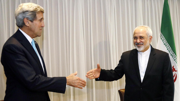 U.S. Secretary of State John Kerry shakes hands with Iranian Foreign Minister Mohammad Javad Zarif before a meeting in Geneva Jan. 14, 2015.