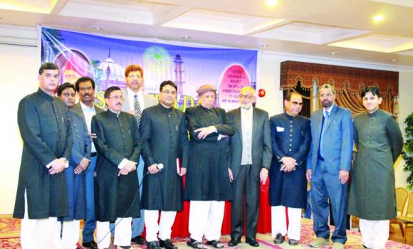 Guests and some of the key organizers pose for a group picture during Sir Syed celebrations in Jubail.