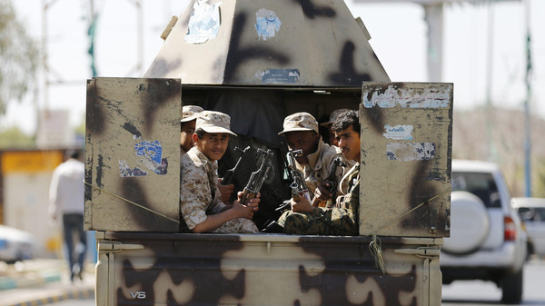 Houthi fighters ride a patrol vehicle outside a hotel hosting U.N.-sponsored negotiations on a political settlement for Yemen's crisis in Sanaa February 19, 2015.