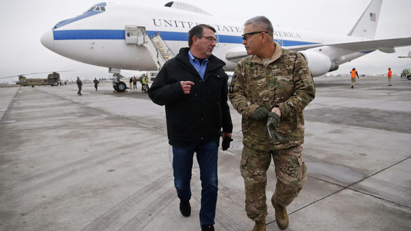 U.S. Secretary of Defense Ash Carter (L) walks with U.S. Army General John Campbell, who greeted him upon his arrival at Hamid Karzai International Airport in Kabul, Afghanistan February 21, 2015.