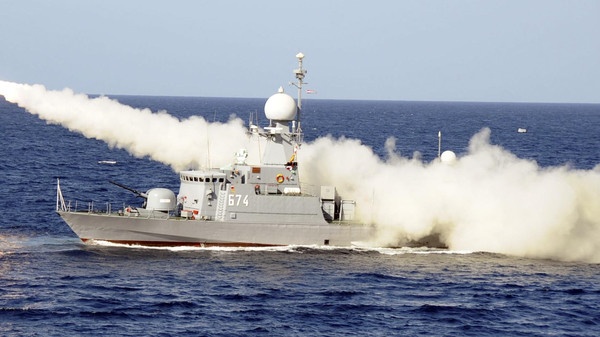 An Egyptian warship fires a missile during a military drill