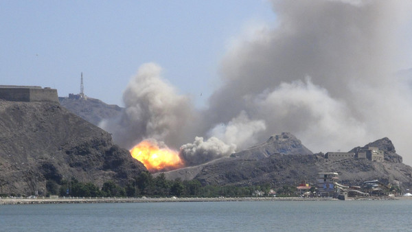 Smoke rises from an arms depot at the Jabal Hadeed military compound in Yemen's southern port city of Aden March 28, 2015.