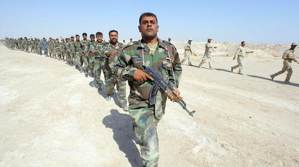 Thousands of Iraqi soldiers and Shiite militiamen sought to seal off ISIS fighters in Tikrit and nearby towns.