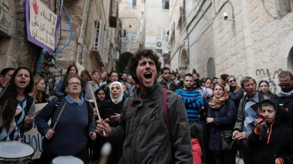Israeli, foreign peace activists on March 22, 2015 demonstrate in the Muslim Quarter of the Old City of Jerusalem.