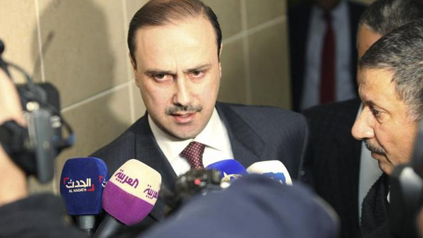 Jordanian Information Minister Mohammed al-Momani speaks to the media.