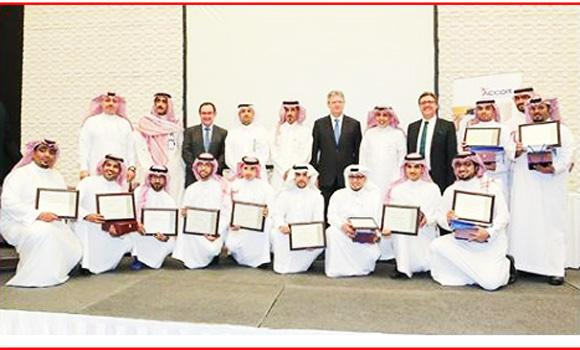 The young Saudis with their certificates after finishing their training program.