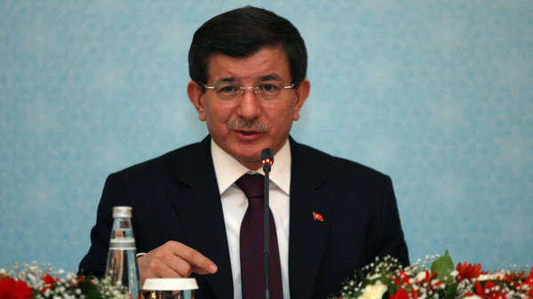 Turkish Prime Minister Ahmet Davutoglu said on Tuesday negotiating with President Bashar al-Assad would be like shaking hands with Adolf Hitler.