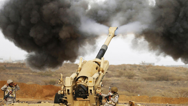 A Saudi artillery unit fires shells towards Houthi positions from the Saudi border with Yemen.