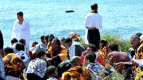 Migrants are seen on the shore in the eastern Aegean island of Rhodes, Geece on Monday, April 20, 2015.