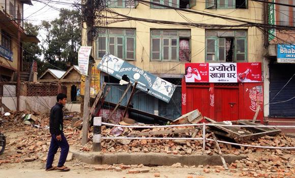 An man walks past damage caused by an earthquake in Kathmandu, Nepal, on Saturday.