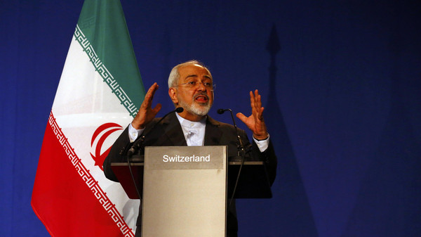 Iran's Foreign Minister Javad Zarif gestures as he speaks during a news conference in Lausanne.
