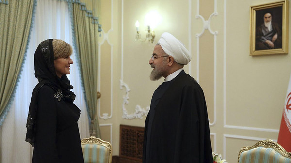 Iran's President Hassan Rouhani, right, greets Australian Foreign Minister Julie Bishop at the start of their meeting in Tehran, Iran, Saturday, April 18, 2015.