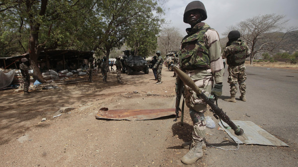 Nigerian Soldiers man a check point in Gwoza, Nigeria, a town newly liberated from Boko Haram.