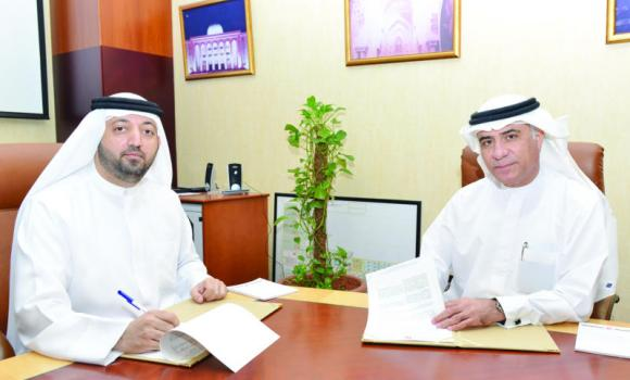 Saud Salim Al-Mazrouei, director of SAIF Zone and Hamriyah Free Zone Authority, and Jawad Al-Redha, regional director — public sector — Microsoft, signing the MoU.