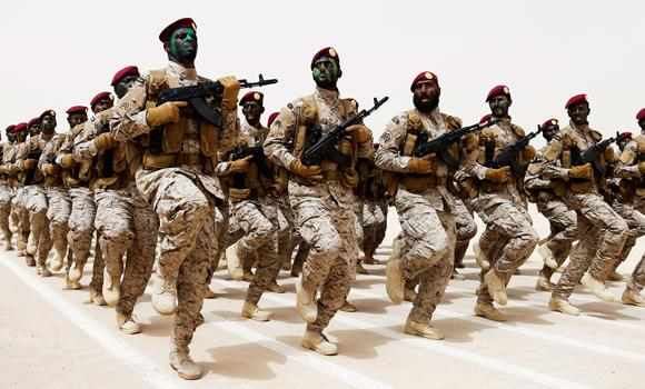 In this April 29, 2014 file photo, Saudi soldiers march during Abdullah's Sword military drill in Hafar Al-Batin.