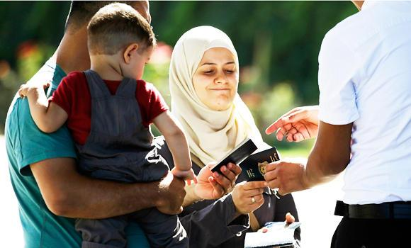 Syrian refugees have their passports checked at the Turkish Cilvegozu gate border, in this Sept. 10, 2013 file photo.