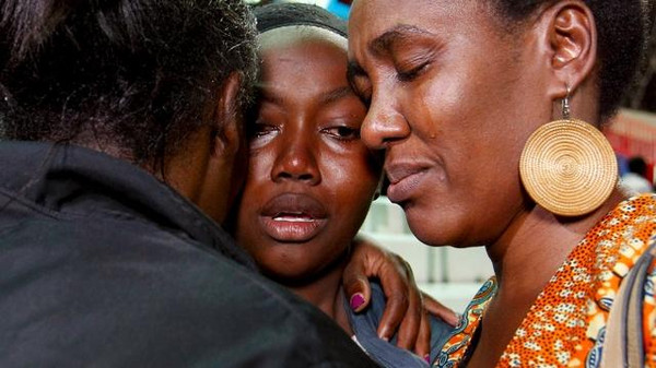 People react after meeting their relative (C) who was rescued from the Garissa University attack at Nyayo stadium in Kenya's capital Nairobi April 4, 2015.