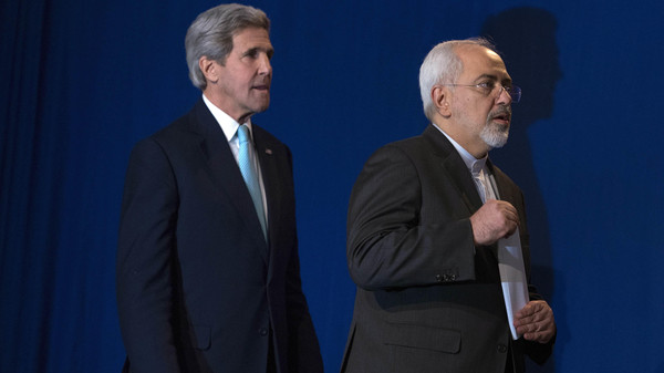 U.S. Secretary of State John Kerry, left, and Iranian Foreign Minister Javad Zarif arrive to deliver a statement, at the Swiss Federal Institute of Technology.