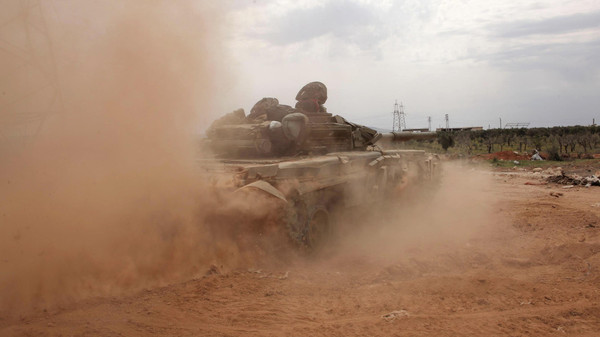 A Syrian army tank is seen in the al-Maamel area in Aleppo's countryside.