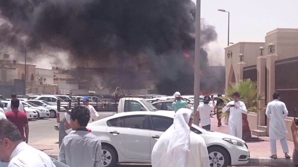 Firemen work at the site where a car exploded near a Shi'ite mosque in Saudi Arabia's Dammam May 29, 2015.