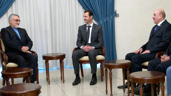 A handout picture released by the official Syrian Arab News Agency on May 13, 2015 shows President Bashar al-Assad (C) meeting with Chairman of the Iranian Shura Council's Committee for Foreign Policy and Syria's security services chief Ali Mamluk in Damascus.