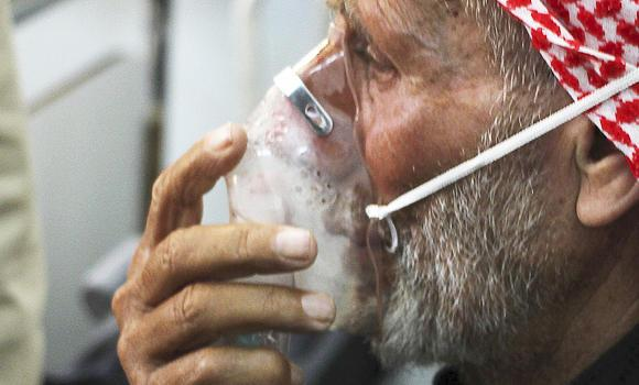 A man breathes through an oxygen mask after what activists said was a chlorine gas attack on Kansafra village at Idlib, Syria.