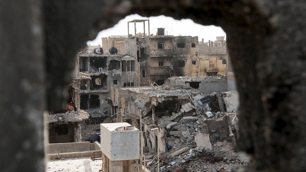 Damaged buildings are pictured after clashes between forces in Benghazi