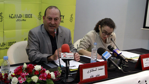 Amnesty International director Mohammed Sektaoui, left, addresses reporters at a press conference next to Amnesty researcher Sirine Rached.