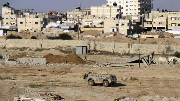 An Egyptian army armored vehicle stands on the on the Egyptian side of border town of Rafah, north Sinai.