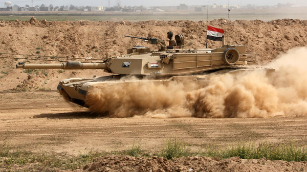 An Iraqi Army tank prepares to attack ISIS extremists in Tikrit, 130 kilometers north of Baghdad, March 13, 2015.